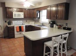 white kitchen appliances with wood cabinets interior design