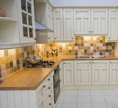cool primitive backsplash ideas with white cabinets and brown