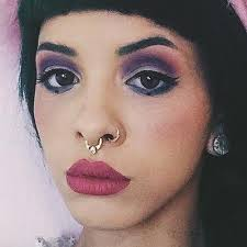 Melanie Martinez wore a colorful makeup in matte shades Description from…