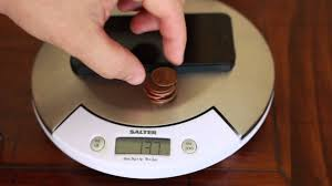 How much does the iPhone 5 Weigh 10 pennies less than the iPhone