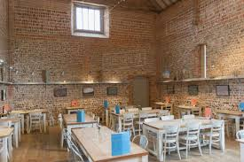 100 Brick Ceiling Tables In Vacant Restaurant With Brick Walls And Vaulted Ceiling