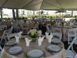 Barkley House Garden Wedding Champagne Overlays White Chairs Silver Chargers