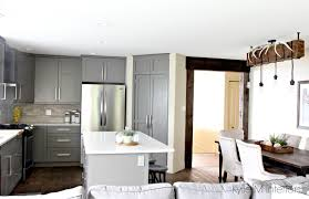 Open Layout Kitchen And Dining Room Cabinets Painted Benjamin Moore Amherst Gray White Quartz Island Doorway Beams In Reclaimed Wood Diy Light
