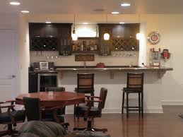 White Lamp On The Ceiling Home Bar Ideas Small It Also Has Round Dining Table With Black Seat Wooden Floor Wall Cabinet