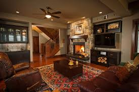 Glamorous Monte Carlo Ceiling Fans In Living Room Traditional With Stone Fireplace And Tv Next To Raised Hearth Alongside Rustic