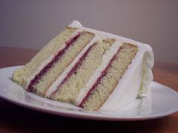 Moist white cake white chocolate cream and seedless raspberry spread iced with creamy buttercream icing