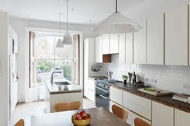 modern white narrow kitchen kitchen design ideas houseandgarden