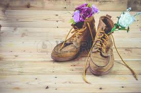 Old Shoes And Flower On A Wooden BackgroundVintage Concept Stock
