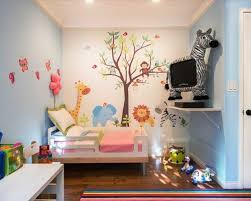 Trendy Girl Medium Tone Wood Floor Kids Room Photo In Los Angeles With Multicolored Walls