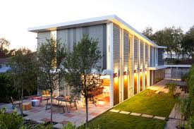 white concrete wall home design with transparent glass windows and