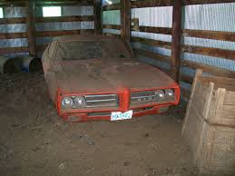 1969 Pontiac GTO Judge Front Barn Find Photo 1 | Here Comes The ... Holzmans Tasures The Barn Find Truth About Cars Old Cadillacs Found In Rundown Barn New Hampshire Shows Up At Hershey Hemmings Daily Deuce Unstored Classic French Barnfind Collection Brings 285 Million Sets 10 Records Amazing Discovery Of Vintage Cars Mirror Online 40 Stunning Discovered Ultimate Cadian Find Driving 18m Worth Classic A Company Works To Store 18 Incredible Classics Found Tucked Away In An Warehouse Barnfound Aston Martin Dbs Headed To Auction News Gallery Top Forza Horizon 3 Car Finds Visual Guide Vg247