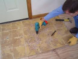 how to remove ceramic tile from concrete floor without breaking