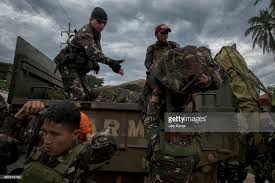 siege liberation duterte declares marawi liberated after five month siege photos