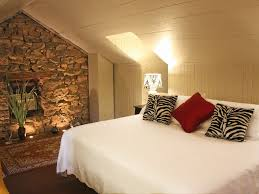 DecorationsLovely Master Bedroom Decor With River Stone Accents Wall Plus Cozy Brown Arm Chair
