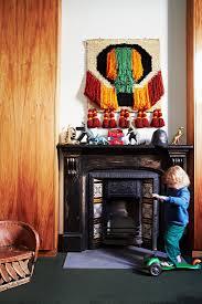 kleinkind mit roller vor antikem kamin bild kaufen