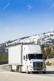 White Semi Truck 18-Wheeler On Snowy Mountain Pass. Stock Photo ...