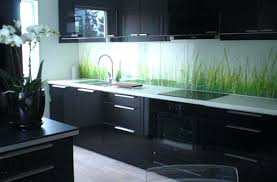 Kitchen Backsplash Ideas With Dark Wood Cabinets by Black Wood Cabinetry And Island Contrast With Patterned Tile