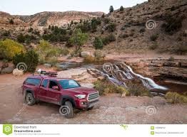 Red Pickup Camping Rig On Rocky Trail Near Waterfall In Southern ...
