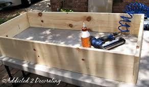 make a factory cart coffee table from reclaimed cedar fence boards