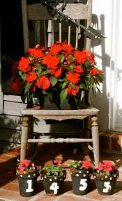 29 Best Front Door Flower Pots (Ideas And Designs) For 2018 Painted Flower Pots For The Home Pinterest Paint Flowers Beautiful House With Nice Outdoor Decor Of Haing Creative Flower Patio Ideas Tall Planter Pots Diy Pot Arrangement 65 Fascating On Flowers A Contemporary Plant Modern 29 Pretty Front Door That Will Add Personality To Your Garden Design Interior Kitchen And Planters Pictures Decorative Theamphlettscom Brokohan Page Landscape Plans Yard Office Sleek