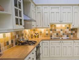 white subway tile backsplash with white cabinets kitchen