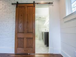How To Install Barn Doors | DIY Network Blog: Made + Remade | DIY Beautiful Built In Ertainment Center With Barn Doors To Hide Best 25 White Ideas On Pinterest Barn Wood Signs Barnwood Interior 20 Home Offices With Sliding Doors For Closets Exterior Door Hdware Screen Diy Learn How Make Your Own Sliding All I Did Was Buy A Double Closet Tables Door Old