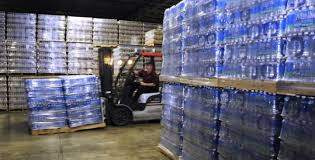 At CPF Co Op In Ayer Yesterday A Forklift Moved Pallets Of Aquafina Bottled