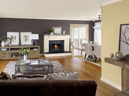 interior living room with brown sofa and wooden floor also neutral