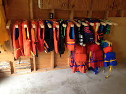 Kayak Ceiling Hoist Nz by Space Saving Life Jacket Rack Home Sweet Home Someday