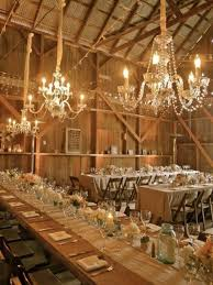 Stunning Rustic Country Wedding Reception Decorations With Exposed Beam Ceiling And Long Tables Also Small Chairs