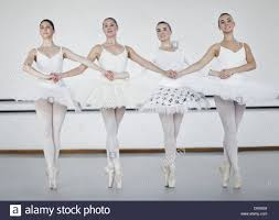 ballet dancers holding hands in studio stock photo royalty free