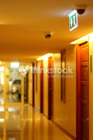 hallway of apartment building in yellow tungsten light stock photo