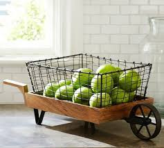 Wheelbarrow Is Made Of Mango Wood And Iron Basket With A Blackened Finish Find This Pin More On Kitchen Decor Items