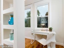 modern home office with hardwood floors built in bookshelf in