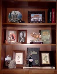 Decorating Bookshelves Without Books by Ideas For Decorating With Travel Souvenirs The Enchanted Manor