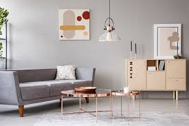 real photo of a modern living room interior with a sofa copper