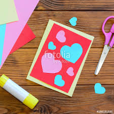 Valentines Day Or Mothers Greeting Card With Pink And Blue Hearts Scissors Glue
