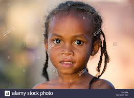 Close Up Portrait Of Malagasy Child Young Girl With Braided Hair In