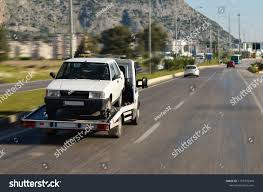 Tow Truck Carrying Car Stock Photo (Edit Now) 1159770949 - Shutterstock Home Matchett Towing Recovery Pensacola Tow Truck Jerr Dan Trucks Nashville Tn Rembrance For Driver Killed In Train Crash Quality Preowned Dodge Dakota At Eddie Mcer Automotive Quality Car Stock Photos Uniforms Ud Bobs Auto Repair Types
