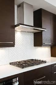 beautiful tile in this kitchen backsplash from ideal cabinetry