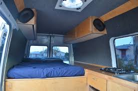 DIY Sprinter Camper Van Interior Showing Bed Cabinets And Cooktop Photo 3Up