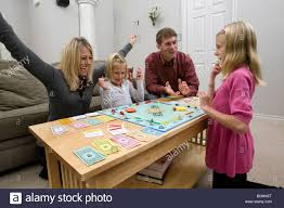 Family Playing Board Game Monopoly