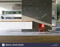 100 Weinstein Architects Red Moulded Chair Against Concrete Wall In House Designed By