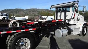 Used PETERBILT 365 Roll Off │Charter & Company Truck Sales - YouTube