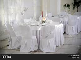 Table Chairs Covered Image & Photo (Free Trial) | Bigstock Wedding Table Set With Decoration For Fine Dning Or Setting Inspo Your Next Event Gc Hire Party Rentals Gallery Big Blue Sky Premier Series And Wood Folding Chair With Vinyl Seat Pad Free Storage Bag White Starlight Events South Wales Home Covers Of Lansing Decorations Chiavari Elegant All White Affaire Black White Red Gold Reception Decorations Pink Oconee Rental In Athens Atlanta