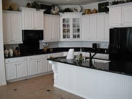 White Cabinets Dark Countertop What Color Backsplash by Black White Kitchen Cabinets Zamp Co