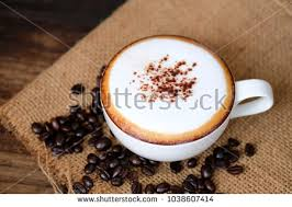 Mocha Coffee In The Wood Table With Bean On Sackcloth