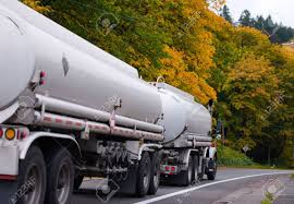 100 Semi Truck Fuel Tanks Modern Big Rig Pulling Two White Tank Trailers With