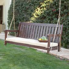 Exterior Dark Wood Porch Swings With White Cushions And Natural