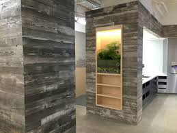 adding a reclaimed wood wall sustainable lumber company